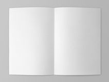Blank folded flyer on gray Stock Photos