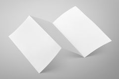 Blank folded flyer on gray Stock Images