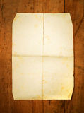 Blank folded paper on board as background Stock Photography