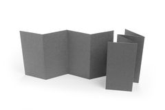 Blank folded paper leaflet or flyer mockup. Stock Image