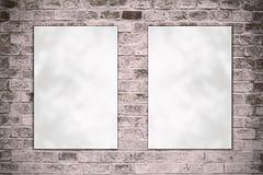 Blank folded paper poster hanging on old brick wall Stock Image