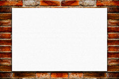 Blank folded paper poster hanging on old brick wall. Stock Image