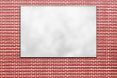 Blank folded paper poster hanging on red brick wall Stock Photo