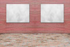 Blank folded paper poster hanging on red brick wall Royalty Free Stock Photos