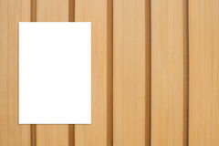Blank folded paper poster hanging on wooden wall,Template mock u. P for adding your design stock photo