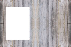Blank folded paper poster hanging on wooden wall. Royalty Free Stock Photography
