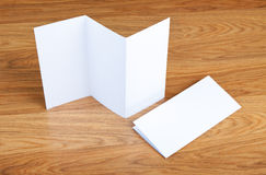 Blank folding page booklet on wooden background. Stock Photo