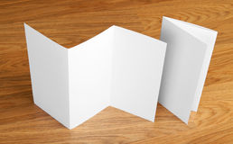 Blank folding page booklet on wooden background. Stock Image