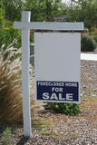 Blank foreclosed sale sign. Property for sale sign with foreclosed sale rider attached Stock Photos
