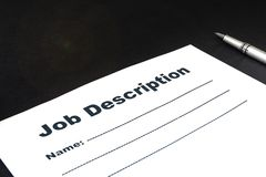 Blank form Job description with pen on black background. Blank form Job description and pen on black background close-up royalty free stock photo