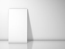 Blank frame against white wall with copy space Royalty Free Stock Image