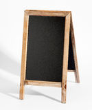 Blank A-frame blackboard on white Stock Images