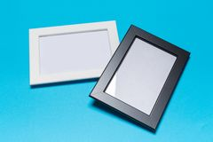 Blank frame on a blue background stock photography
