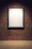 Blank frame on the brick wall Royalty Free Stock Image
