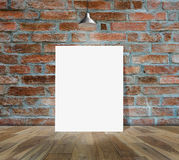 Blank frame on brick wall and wood floor. For information message Royalty Free Stock Photo
