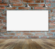 Blank frame on brick wall and wood floor. For information message Stock Images