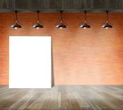 Blank frame on brick wall and wood floor. For information message Stock Photography