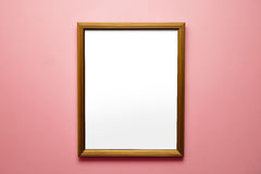 Blank frame on a bright pink wall Royalty Free Stock Photography