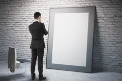 Blank frame with businessman Stock Photo