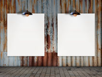Blank frame with Ceiling lamp in Dirty tile room Royalty Free Stock Photo