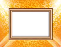 Blank frame on a colored wall lighting spotlights Stock Images