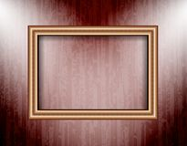 Blank frame on a colored wall lighting spotlights Royalty Free Stock Photos