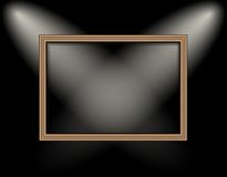 Blank frame on a colored wall lighting spotlights Stock Photos