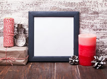 Blank frame and craft style Christmas decor. Royalty Free Stock Images