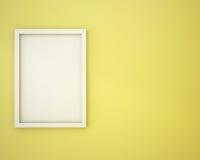 Blank frame on custard yellow  wall Royalty Free Stock Photo