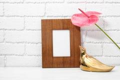Blank frame, decorative bird figure and flower Stock Photos