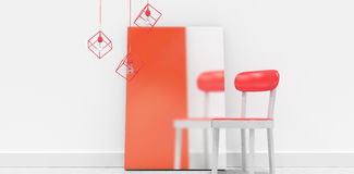 Blank frame by empty chair against wall. At home Royalty Free Stock Images
