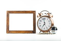 Blank, frame, golden alarm clock. On white background Stock Photography