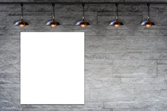 Blank frame on Granite stone decorative brick wall with lamp Stock Photos