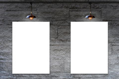 Blank frame on Granite stone decorative brick wall with lamp Royalty Free Stock Image