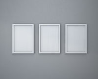 3 Blank frame on  gray wall. 3 White Blank frame on  gray wall Stock Photo