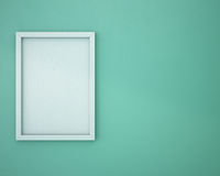 Blank frame on green wall. Stock Photography