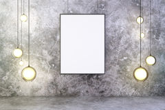 Blank frame with lightbulbs in a concrete room Stock Photo