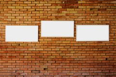 3 blank frame mock up on a brick wall. 3 blank frame mock up on a old brick wall Stock Photos