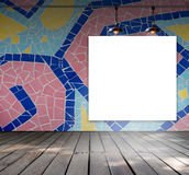 Blank frame on mosaic tile wall with Ceiling lamp Stock Photography