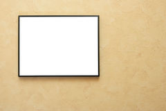 Blank frame over yellow wall royalty free stock image
