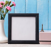 Blank frame, pink flower and souvenir Eiffel tower. French style mock up Stock Image