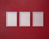 3 Blank frame on  red wall. 3 White Blank frame on  red wall Royalty Free Stock Images