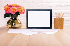Blank frame, roses and stationery Royalty Free Stock Images