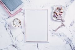 Blank frame and sewing items over marble table Stock Images