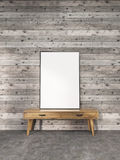 Blank frame on stand. Blank picture frame on small wooden stand in interior with plank wall and concrete floor. Mock up, 3D Rendering Royalty Free Stock Images