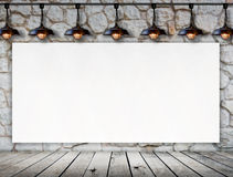 Blank frame on stone wall and wood floor Royalty Free Stock Images