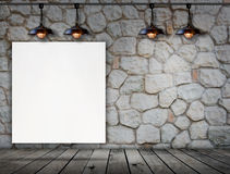 Blank frame on stone wall and wood floor Royalty Free Stock Image