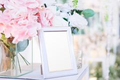 Blank  frame on the table and flower decoration Stock Photos