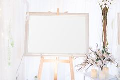 Blank  frame on the table and flower decoration Royalty Free Stock Images