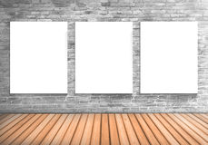 Blank frame three white board on a concrete blick wall and woode Royalty Free Stock Photos